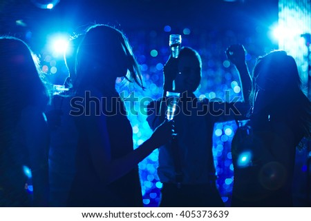 People hanging put in nightclub with champagne - stock photo