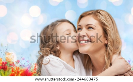 people, happiness, love, family and motherhood concept - happy daughter hugging and kissing her mother over blue lights and poppy field background - stock photo