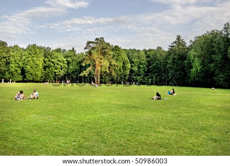 People have a rest on a lawn of city park