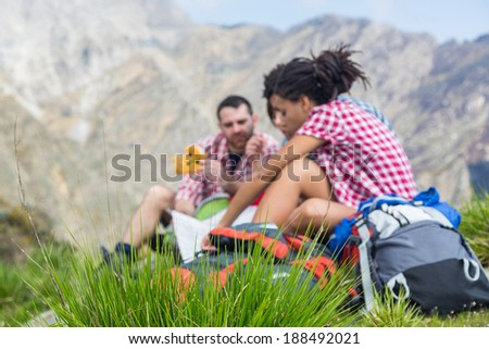 People Having a Rest at top of Mountain