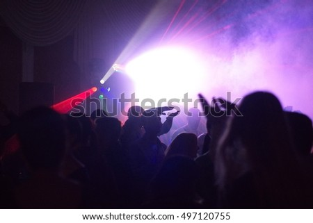 people having fun in a disco. blur effect