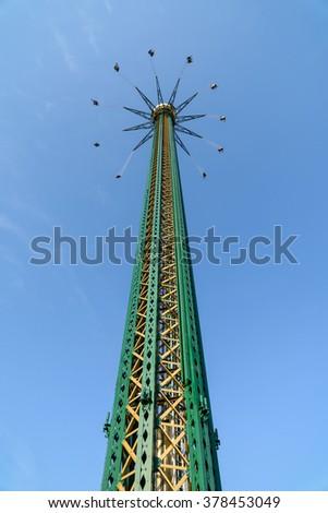 People Having Fun In Carousel Swing Ride At Amusement Park - stock photo