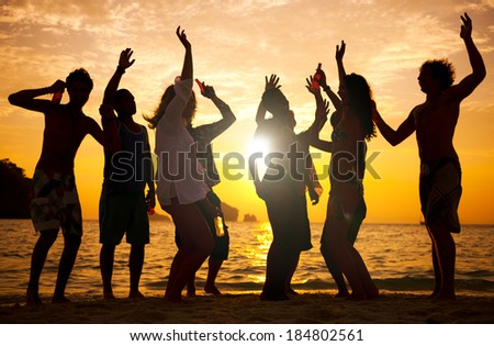 People having fun on the beach. - stock photo