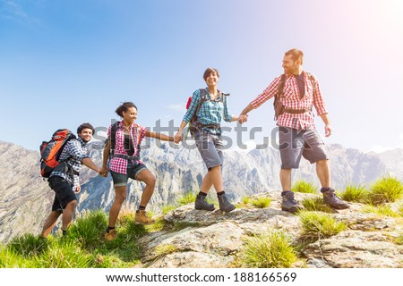 People Hiking at Top of Mountain
