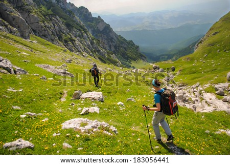 People hiking in the mountains in the summer in Romania - stock photo