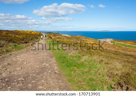 People hiking on Howth cliffs in Ireland on a sunny day - stock photo