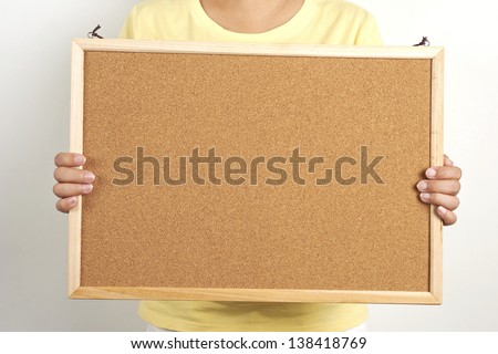 people holding a cork board, leave your messages or inform on the cork board - stock photo
