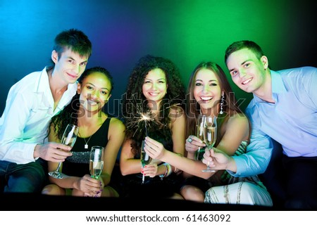 People  holding the glasses of champagne making a toast - stock photo