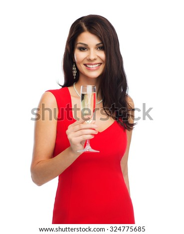 people, holidays, christmas and celebration concept - beautiful sexy woman in red dress with champagne glass - stock photo