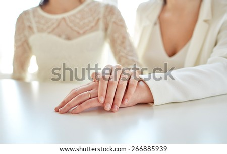 people, homosexuality, same-sex marriage and love concept - close up of happy married lesbian couple hugging - stock photo