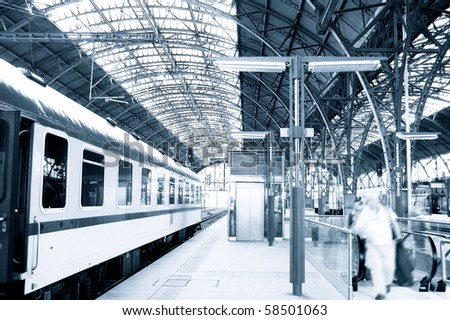 People hurrying for a train on railway station. - stock photo
