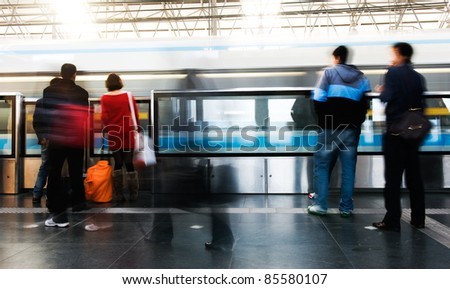 People hurrying to catch a train in shanghai china. - stock photo