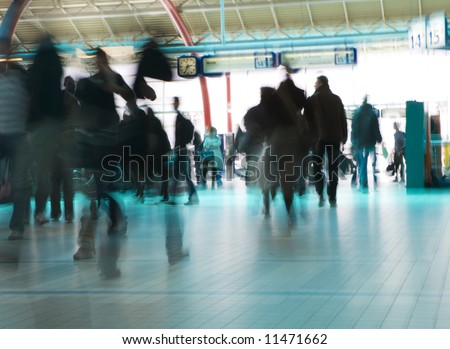 People hurrying to catch a train (or plane) - stock photo