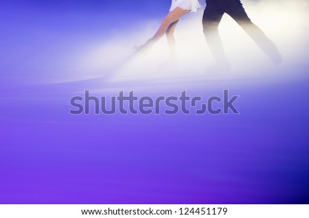 People ice figure skating with beautiful light effect. - stock photo