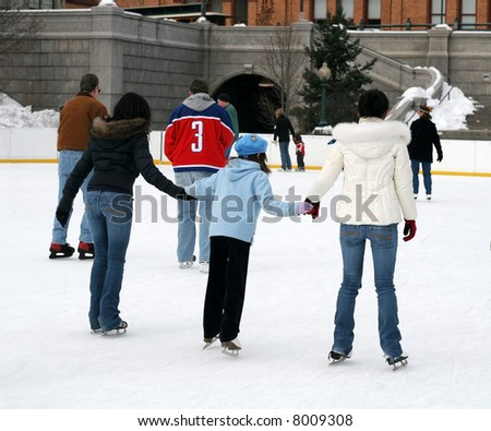 people ice skating - stock photo