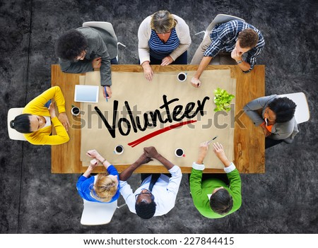 People in a Meeting and Single Word Volunteer - stock photo