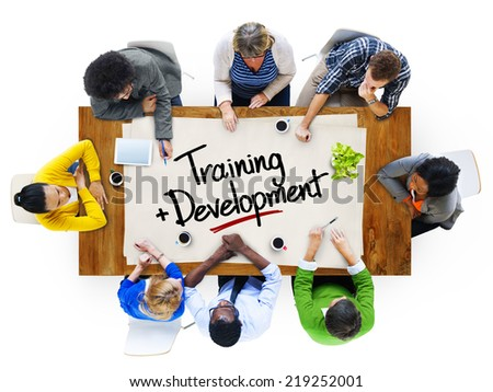 People in a Meeting with Training and Development Concept - stock photo