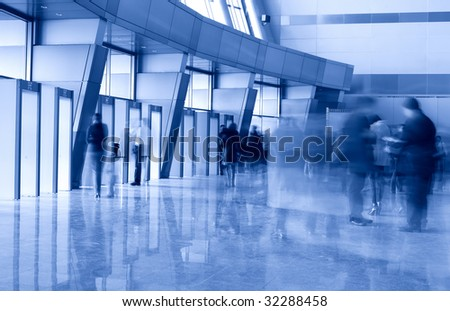 People in a modern architectural interior. Motion blur