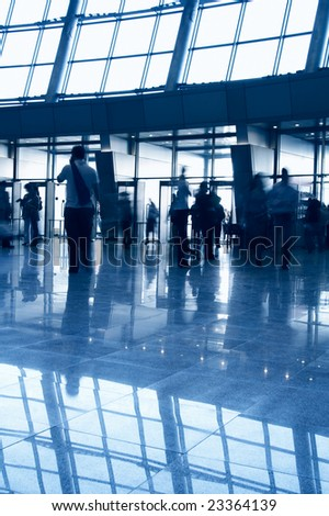 People in a modern architectural interior. Tint blue