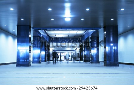 People in a modern architectural interior. Tint blue - stock photo