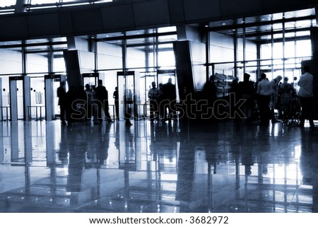 People in a modern architectural interior. Tint in blue