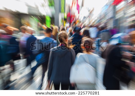 people in a pedestrian zone of the city with creative zoom effect, made by camera - stock photo