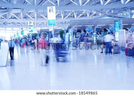 People in airport. Blurred. No recognizable faces or brandnames. - stock photo