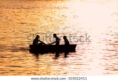 People in boat over sunny warm weather having a good time together - stock photo