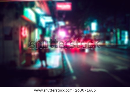 people in bokeh, street of night Bangkok - stock photo