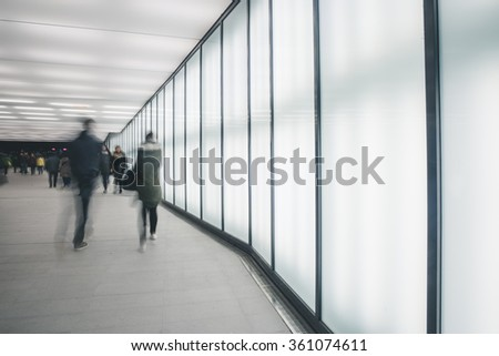 People in bright modern tunnel in the city - stock photo