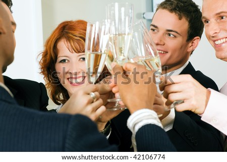 People in business outfit celebrating something in the office - stock photo