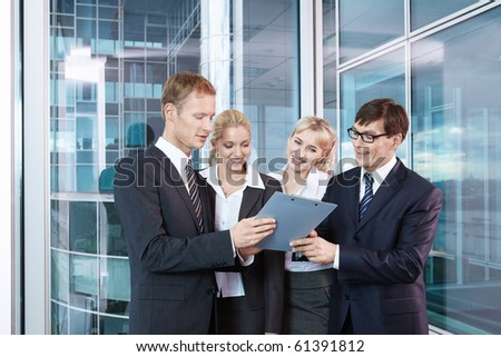 People in business suits are discussed - stock photo
