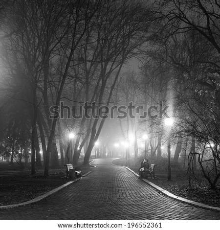 people in city park at night - stock photo