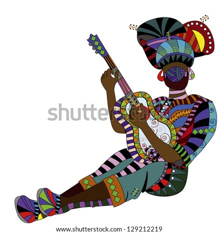 people in ethnic dress playing the guitar his beautiful music - stock photo
