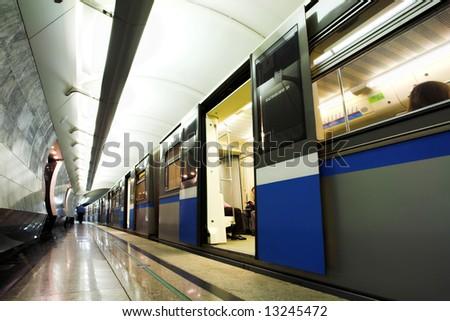 People in fast train subway hall platform - stock photo