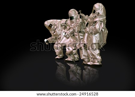 People in fire-resistant clothes on a black background - stock photo