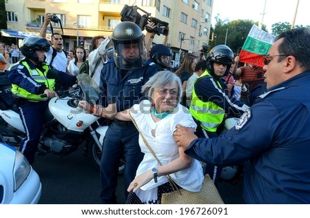 People in front of a police riot, during the ecological protest against construction work at the Bulgarian sea coast - Sofia, Bulgaria - 13, June 2012 - stock photo