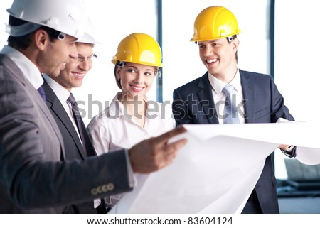 People in helmets on a construction site - stock photo