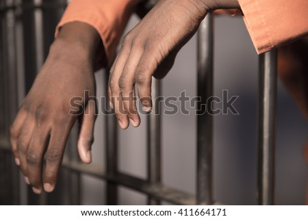 People In Jail - African american man behind bars - stock photo