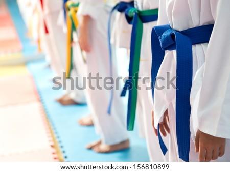 People in martial arts training exercising Taekwondo.  - stock photo