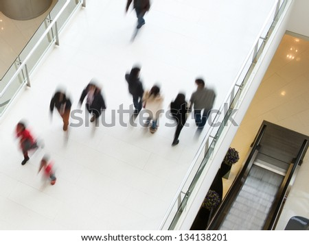 People in motion at the modern shopping mall. - stock photo