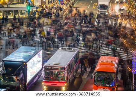 People in motion blur crossing street in Shibuya Tokyo  - stock photo