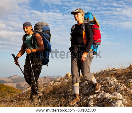 People in mountains - stock photo