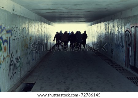 People in Subway. Light at End of Tunnel - stock photo