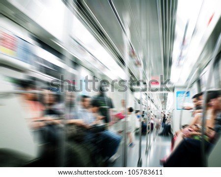 People in subway train - stock photo