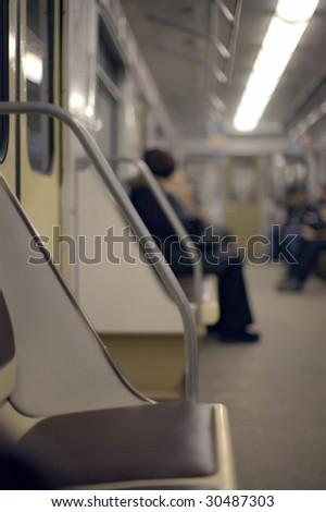 People in subway train - stock photo