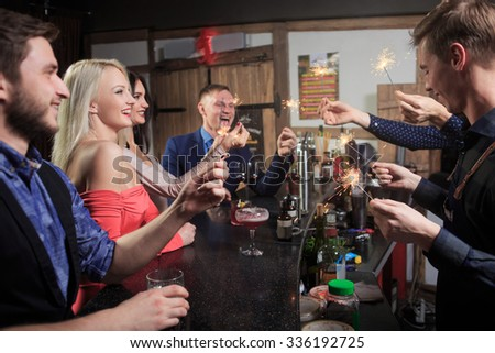 People in the bar. night club. sparklers - stock photo