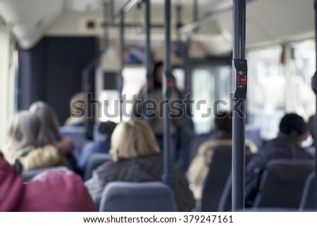 people in the bus, focus on the stop sign - stock photo