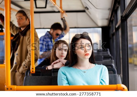 people in the bus. she wondered transport. - stock photo