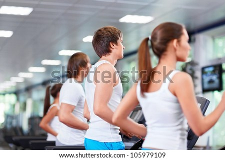 People in the fitness club - stock photo
